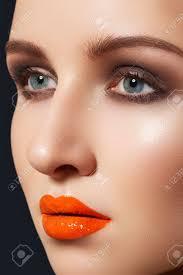 cute woman model with bright fashion make up y lip gloss makeup dark shiseido cle