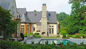 bluestone outdoor fireplace chimney coblestone steps pool patio