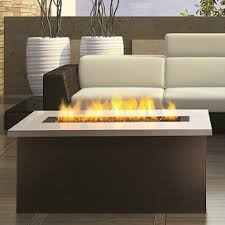 Indoor Coffee Table With Fire Pit Tropical Living Room Ideas With Modern Indoor Fire Pit Coffee Table And Sleek White Cushionsjpg