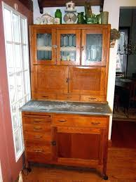 antique hoosier cabinet with flour sifter wagon