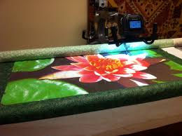 A few photos of the quilting of the 'Water Lily' at Olde City ... & Here ... Adamdwight.com