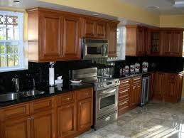 honey oak cabinets black countertops luxury oak cabinets with black granite