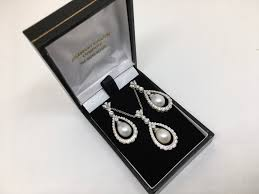18 carat white gold pearl and diamond earring and pendant set