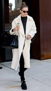 wintry white outerwear on the streets of new york city for more inspiration take a glance at these winning style examples as you prepare to warm up