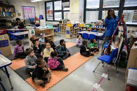 najya hannah jones center background in blue shirt and headband in her kindergarten cl at p s 307 in brooklyn credit glenna gordon for the new york