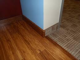 carpet joiner. dark wood trim and carpet joiner
