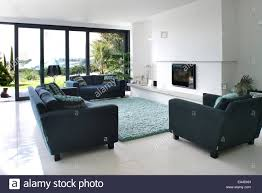 Living Room Uk Open Plan Living Room With Plasma Screen Above Fireplace In Stock