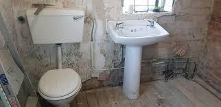 bathroom suite sink toilet and bath