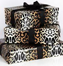 leopard print and black bow gift wrapping ฟ ª ʟ ҝ ᵒ ꏢ τ ʜ ೯ w i Ꮷ ś i ᗠ ও