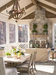 mid sized coastal stone screened in back porch idea in other with a roof