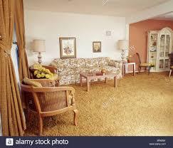 1970s interior design. 1970s ORANGE AND YELLOW LIVING ROOM INTERIOR - Stock Image Interior Design