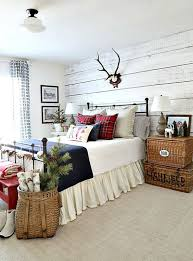 a cozy rustic bedroom dressed up for winter with a whitewashed wood wall a basket
