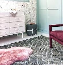 pink sheepskin rugs rug chair covers beautiful and blush uk