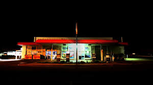 canopy lighting as opposed to lamp post lighting is executed by erecting a canopy or ceiling that completely covers the pumps of a gas station