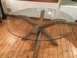 next oak and glass round 140 cm diameter dining table and 6 black faux