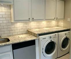 countertop over front load washer and dryer washer dryer workspace with extended granite over and height countertop over front load washer and dryer