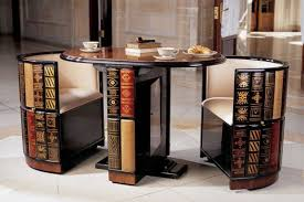 cool library furniture. Very Cool Library Table And Built-in Chairs -- This Folds Closed Into An Oval Shaped With Faux Books All Around. Clever! Furniture