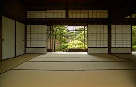 japanese room with sliding shōji doors and tatami flooring