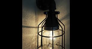 industrial pipe wall sconce mason jar cage light hanormanor