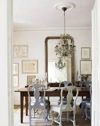it s not only a beautiful addition to this playful dining room which mi a traditional wood table ceiling light and pastel painted chairs