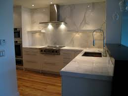 Simple Ikea Kitchen Design With Metal Chimney Extractor Above Modern Stove  Also Recessed Lamp On White ...