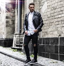 on up white shirt leather biker jacket black ripped jeans and sneaker