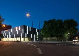 parisian sports hall by ateliers o s with bands of light on its walls