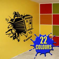 black tardis through a wall in the playroom vinyl wall decal art sticker