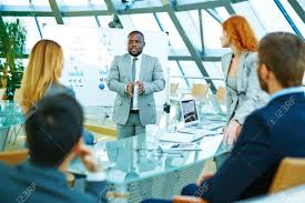 Leader Of Corporation Presenting Business Plans Stock Photo Picture
