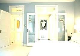 small walk through closet to bathroom master bedroom with walk in closet and bathroom master bathroom