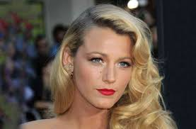 blake lively with side swept curls and bold red lip