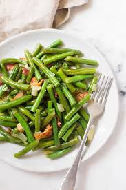 made a close up image of a serving of southern green beans made with fresh green
