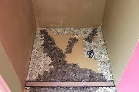 rock tile shower floor river rock shower floor installation image bathroom ceramic tile river rock shower