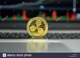 Ripple Trade Chart Golden Ripple Coin On A Black Keyboard Of Silver Laptop And
