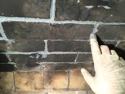 caulked grout joints being finger tooled