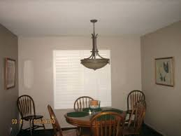 chandelier hanging height above table kitchen to hang pictures