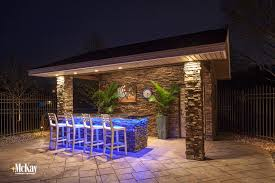 colored led lighting under counter of outdoor kitchen