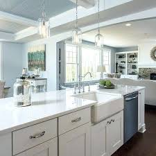 quartz countertops with white cabinets tan