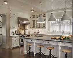 hamptons kitchen design. suzie: john b murray architect - beautiful open kitchen design with white cabinets . love love these lights and stools. hamptons e