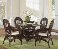 appealing dining e with rattan dining chairs and round gl top table on green carpet