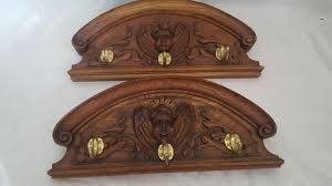 carved oak wall panels with brass hooks