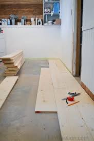 how to install a barn board floor over concrete tutorial