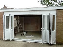bi fold garage doorsWhite bi fold garage doors  Home Interiors