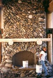 River rock fireplace in Wyoming by Michael Eckerman. Lots more designs of  Michael's here: