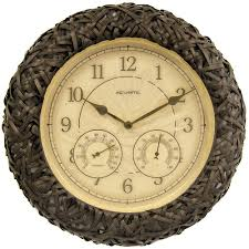 brown wicker wall clock with og thermometer and hygrometer