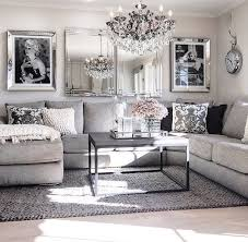 Living Room decor ideas - glamorous, chic in grey and pink color palette  with sectional sofa, graphic black white photography and crystal chandelier.