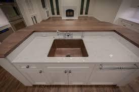 hammered copper sink island transitional kitchen
