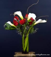bouquet 001 125 plus tax and delivery large and very por arrangement of one dozen red roses with white