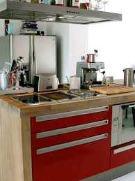 small industrial style kitchen with red cabinets