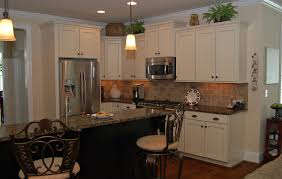 furniture black wooden kitchen islands on the floor connected by white wooden kitchen cabinet and